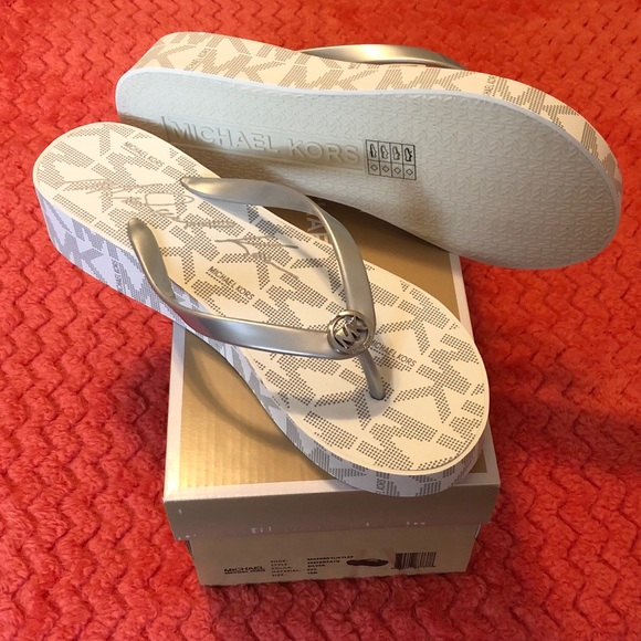 4aa53ffd2c5d0 Michael kors White and silver wedge flip flops 10